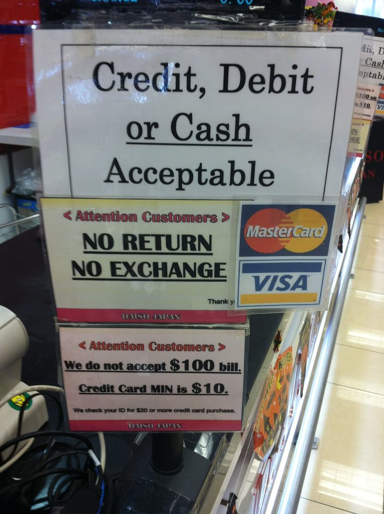 A No Return No Exchange sign posted at a store checkout
